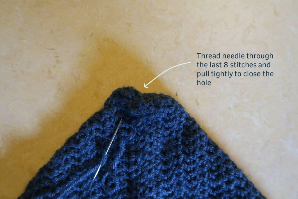 Thread through the last stitches to avoid a pointed hoodie