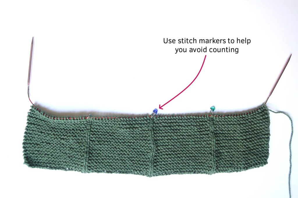 use stitch markers to help you avoid counting for this watercolor poncho knitting pattern