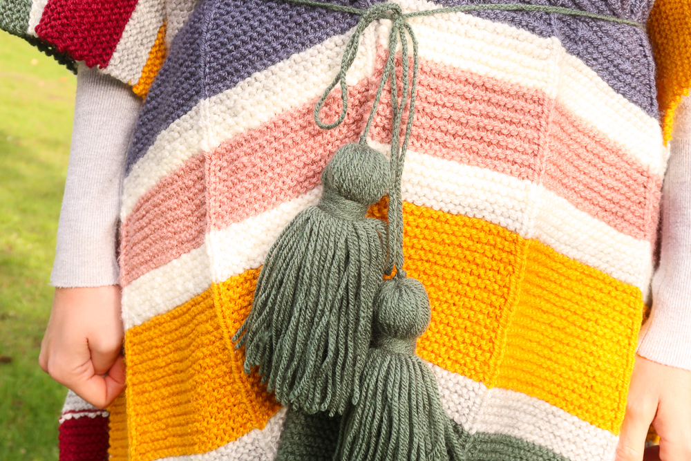 oversized tassels on the watercolor poncho knitting pattern