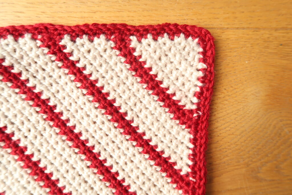 Zoom in on the corner of the crochet square showing the edging