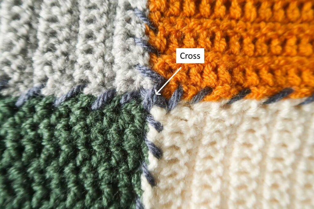Join crochet squares with a cross on this beginner crochet blanket