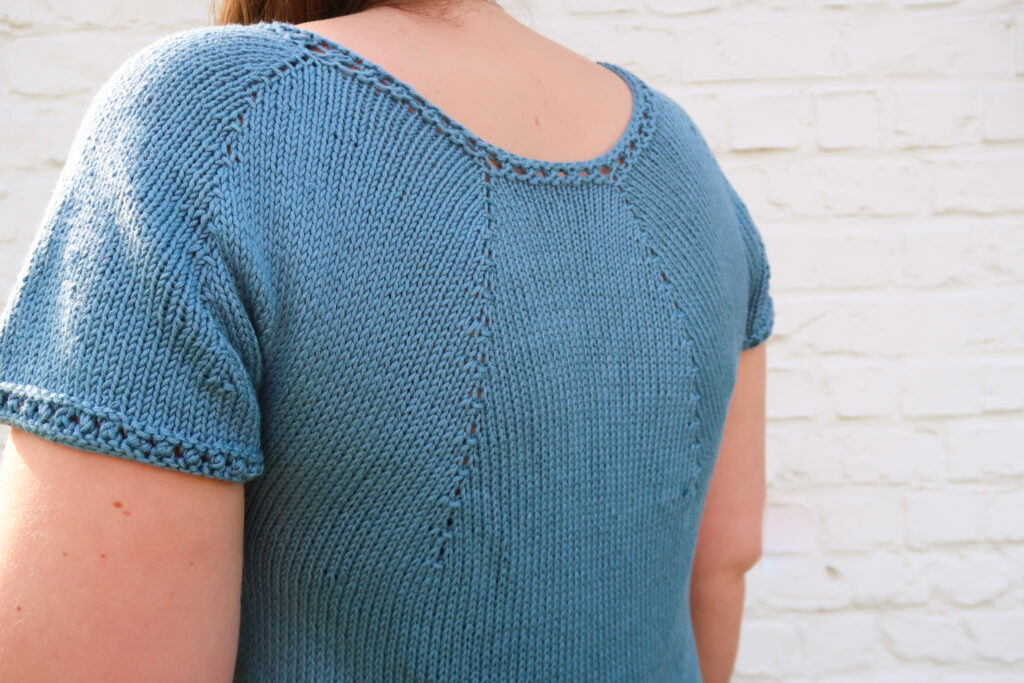 Back details (eyelets on the sleeve and neckline) of the knit summer top pattern