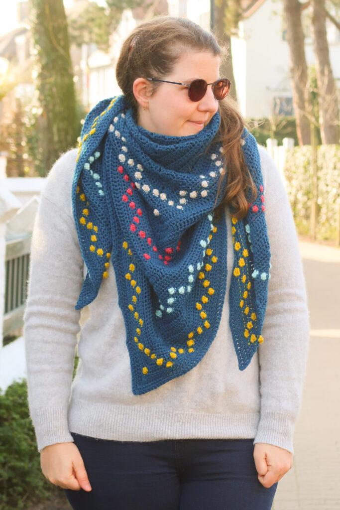 Fairy lights shawl crochet pattern worn as a triangular scarf
