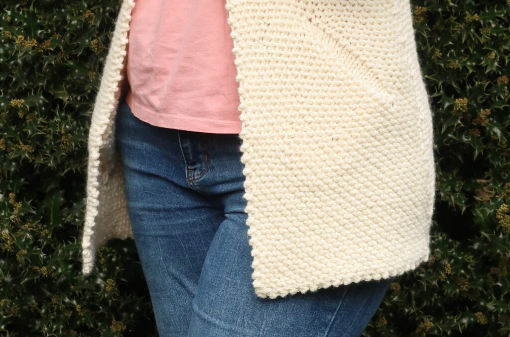 Close up of the insert pocket of the cardigan knitting pattern