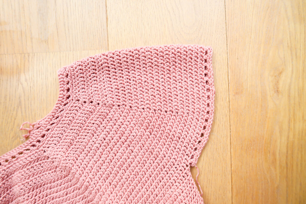 Finished sleeve of the summer crochet top with eyelets