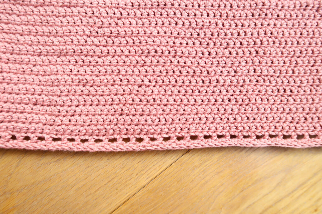 bottom border of eyelets of the body of the crochet top pattern