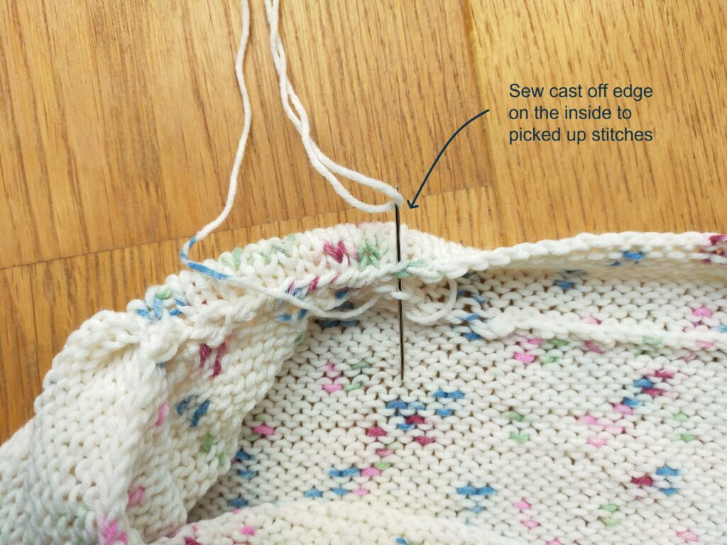 Detailed view to show the bound edges being seemed on the inside of the free knit top pattern