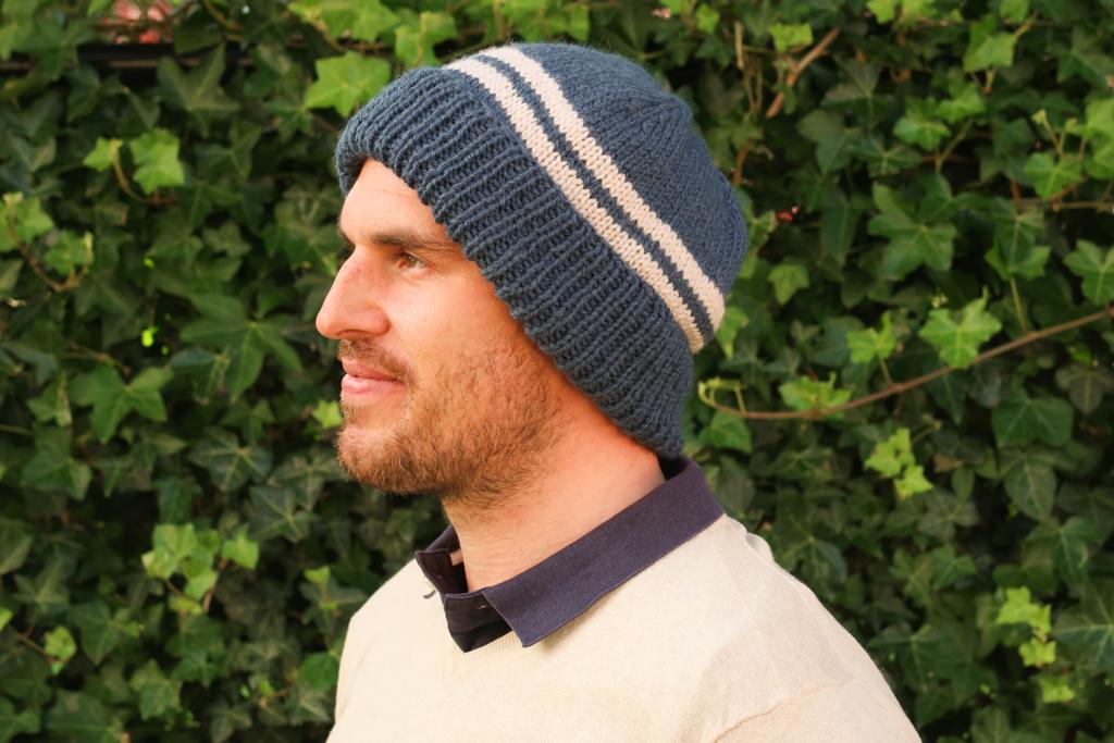 Alex simple hat knitting pattern circular needles worn by a men