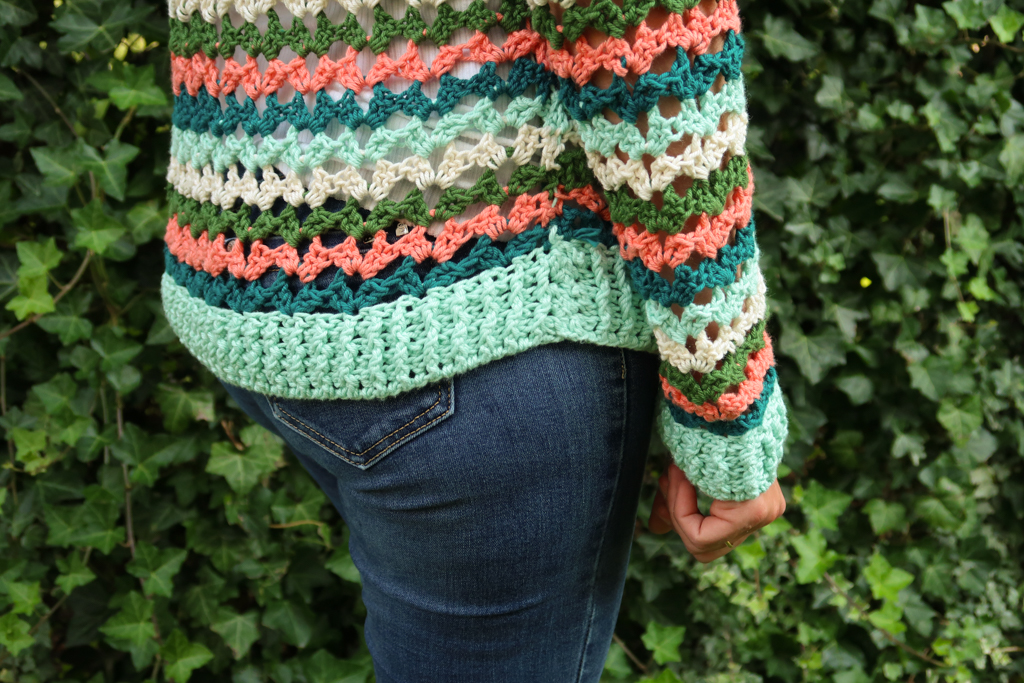 detailed view of the bottom edge and sleeve of the summer sweater crochet pattern